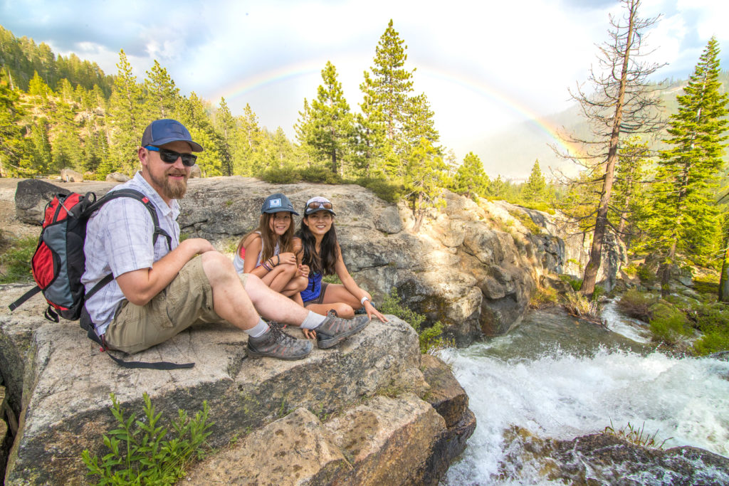 Family taking a hike break on the Shirley Canyon Trail at Squaw Valley