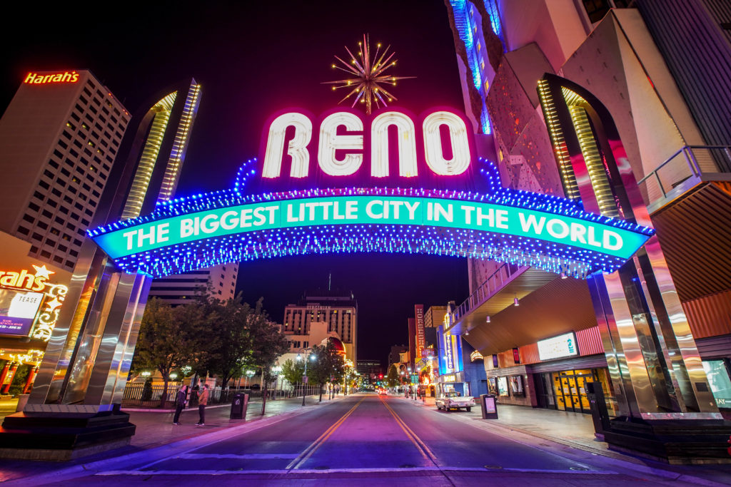 """Reno's iconic sign at night that reads """"The Biggest Little City in the World"""""""